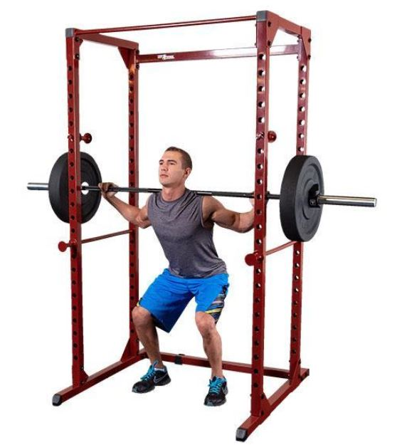 Man doing workout on power rack