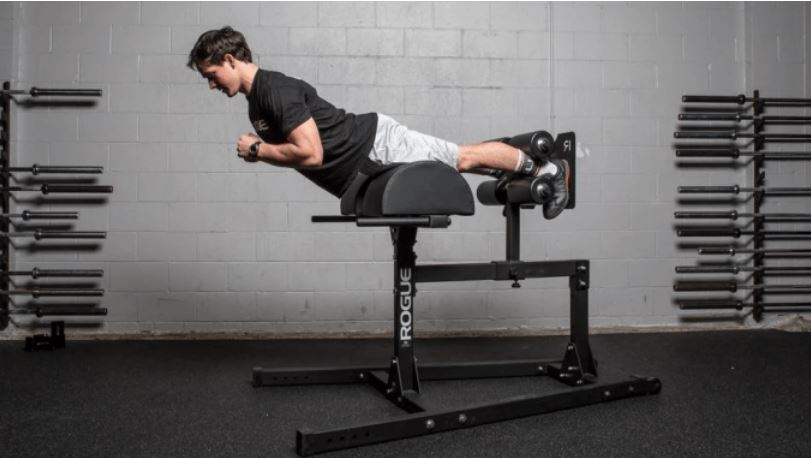Man doing glute hold using roman chair